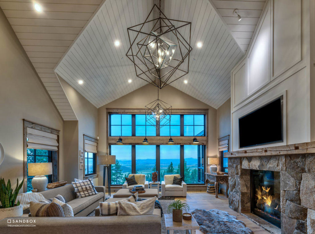SANDBOX-CLEAR-CREEK-TAHOE-12-TRANSITIONAL-GREAT-ROOM-WITH-CUSTOM-STONE-FIREPLACE-AMAZING-CARSON-VALLEY-VIEWS-INTIMATE-FAMILY-GATHERING-SPACE image