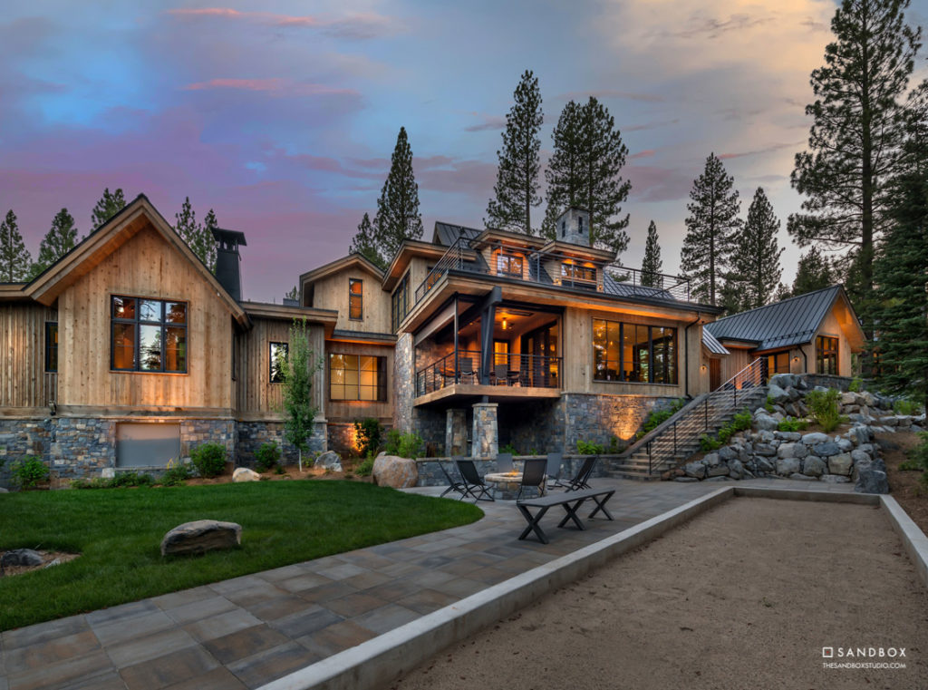 SANDBOX-MARTIS-CAMP-2-MOUNTAIN-TRANSITIONAL-HOME-OUTDOOR-LIVING-BOCCEE-COURT-FIRESIDE-TERRACE-CUSTOM-STONE-FIRE-PIT image